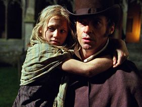 "Isabelle Allen and Hugh Jackman in ""Les Miserables"""