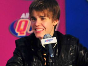 Justin Bieber attends the Stuff Bieber's Bus press conference at the CNN Center on December 23, 2010 in Atlanta, Georgia