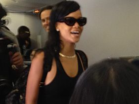 Rihanna boards the plane for her 777 tour