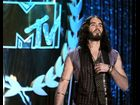 Host Russell Brand plots to draw attention to notorious party boy Charlie Sheen if he botches his performance at the 2012 MTV Movie Awards.