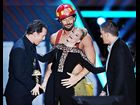 "Elizabeth Banks photographed on stage while accepting the Best On-Screen Transformation award for ""The Hunger Games"" at the 2012 MTV Movie Awards in Los Angeles."