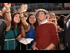 Niall Horan poses with fans on the red carpet